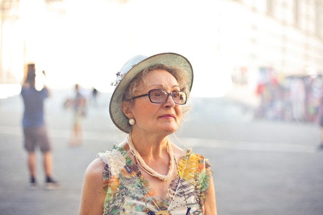Well dressed older woman.